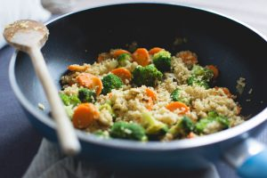 Cous cous with vegetables in a pan