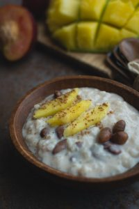 Exotic coconut rice and beans dessert with mango