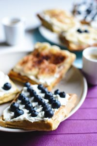 Banana and bluberries waffles with espresso