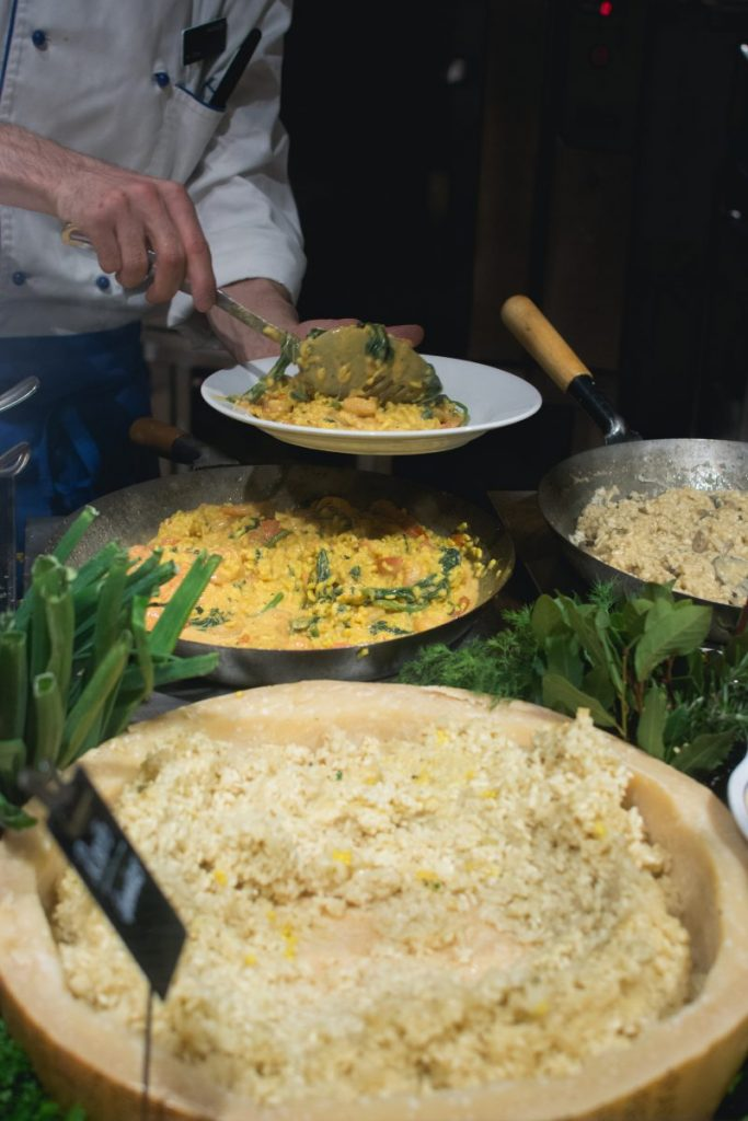 Cook scoops risotto