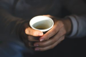 Girl holding coffee espresso