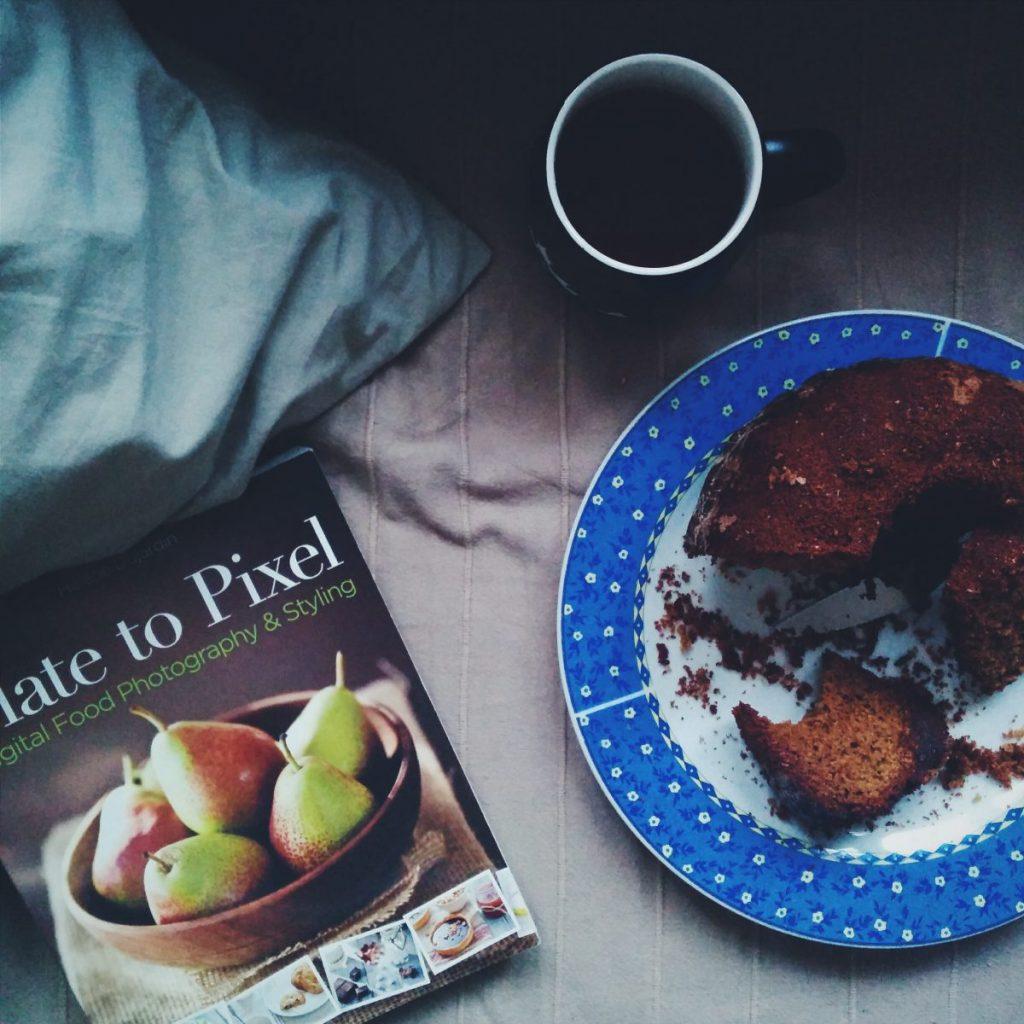 Homemade bun with tea and a book