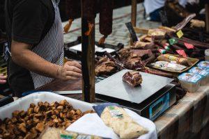Meat vendor at farmers market