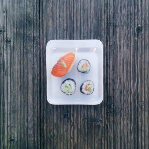 Minimal sushi on wooden background