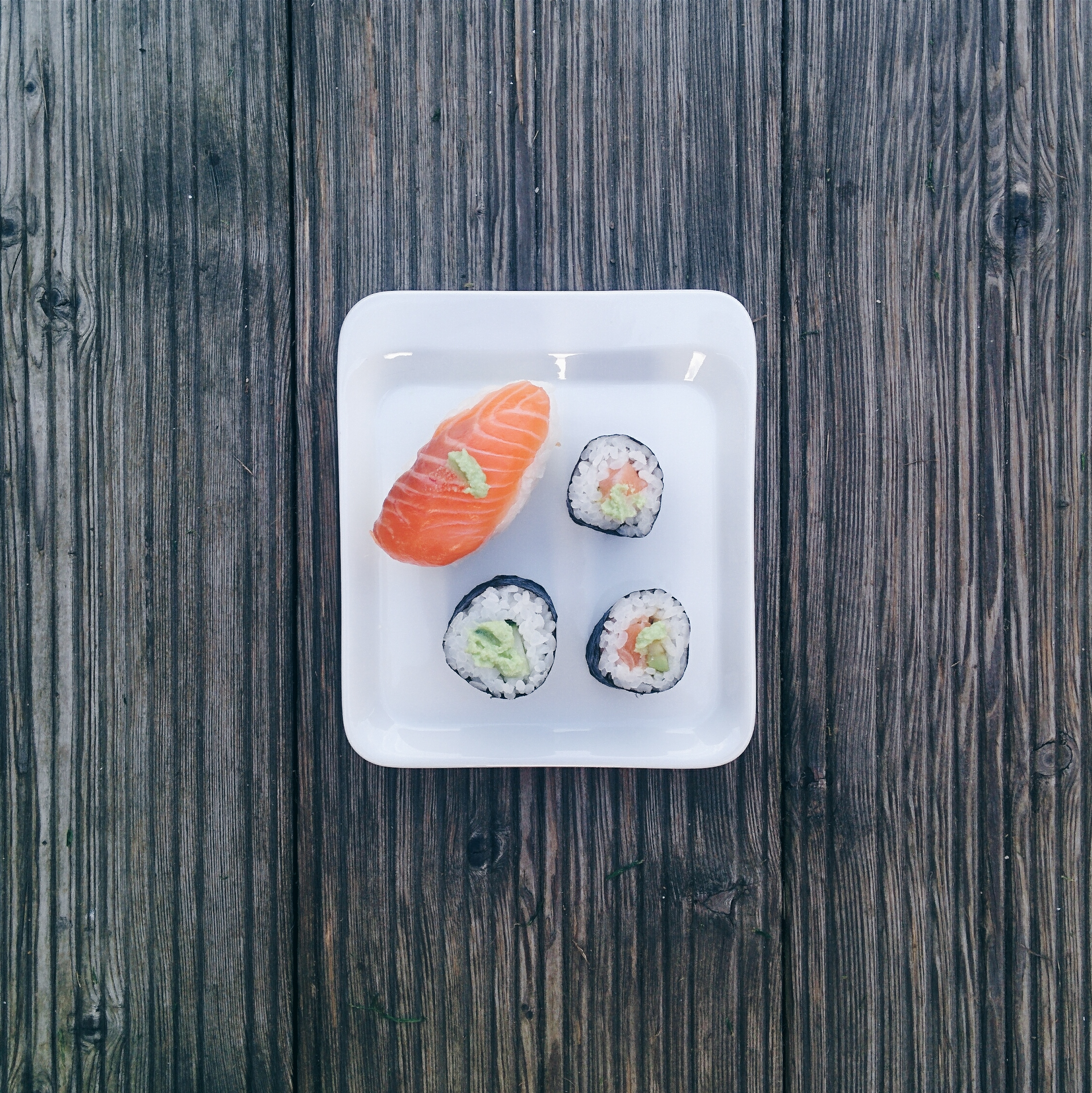 Minimal sushi on wooden background
