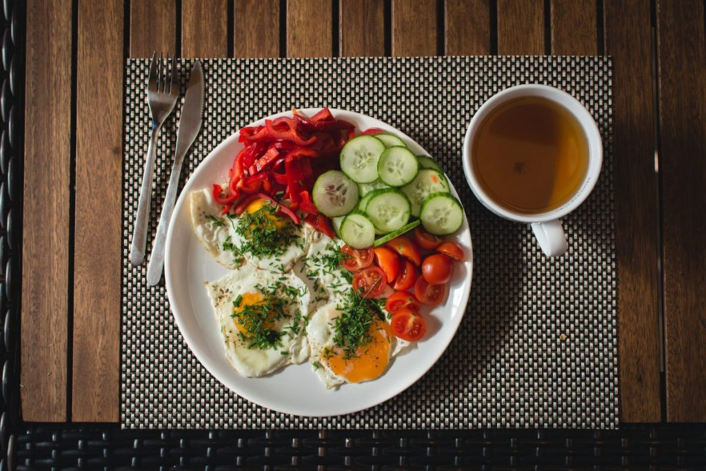 Paleo breakfast eggs with vegetables outside