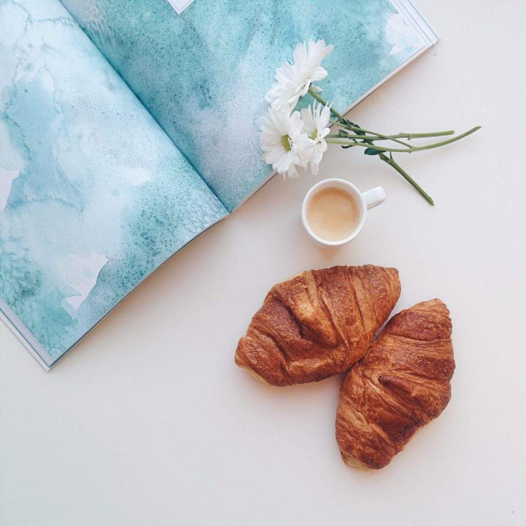 Relaxing with croissants and coffee espresso at home