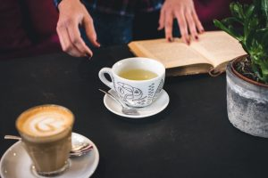 A cup of tea with a book
