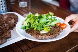 Barbequed beef steak with greens