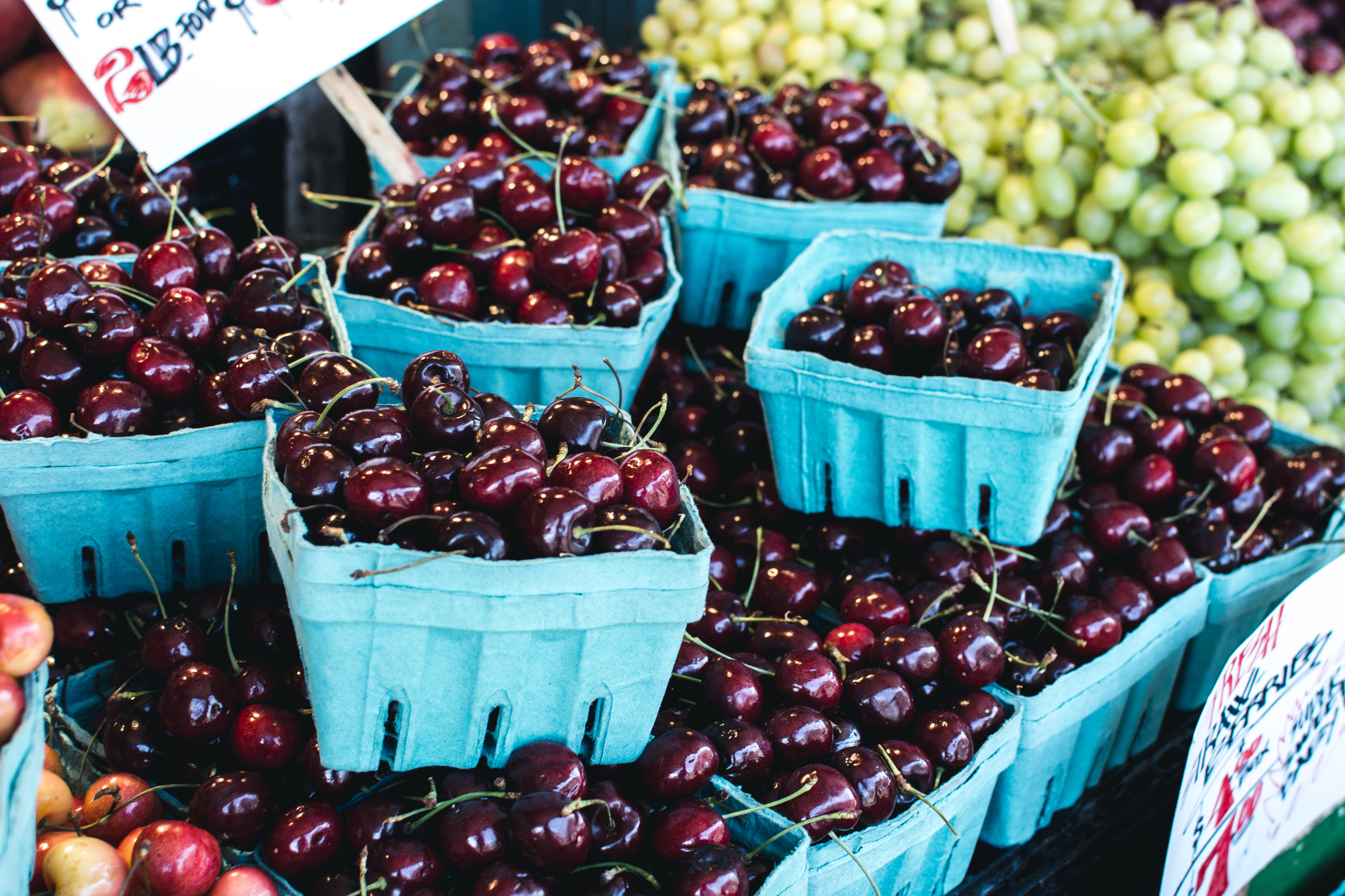 Dark red cherries on a market