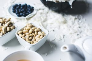 Peeled almonds with coconut and blueberries