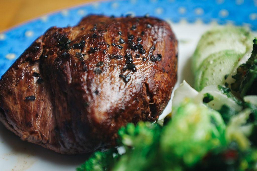 Beef steak with black salt close up