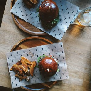 Beef burgers with homemade baked potatoes from above