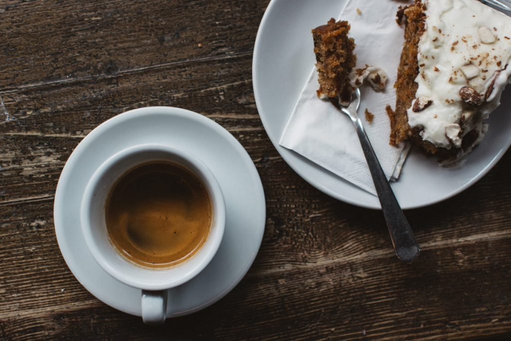 Espresso with carrot cake at a wooden table