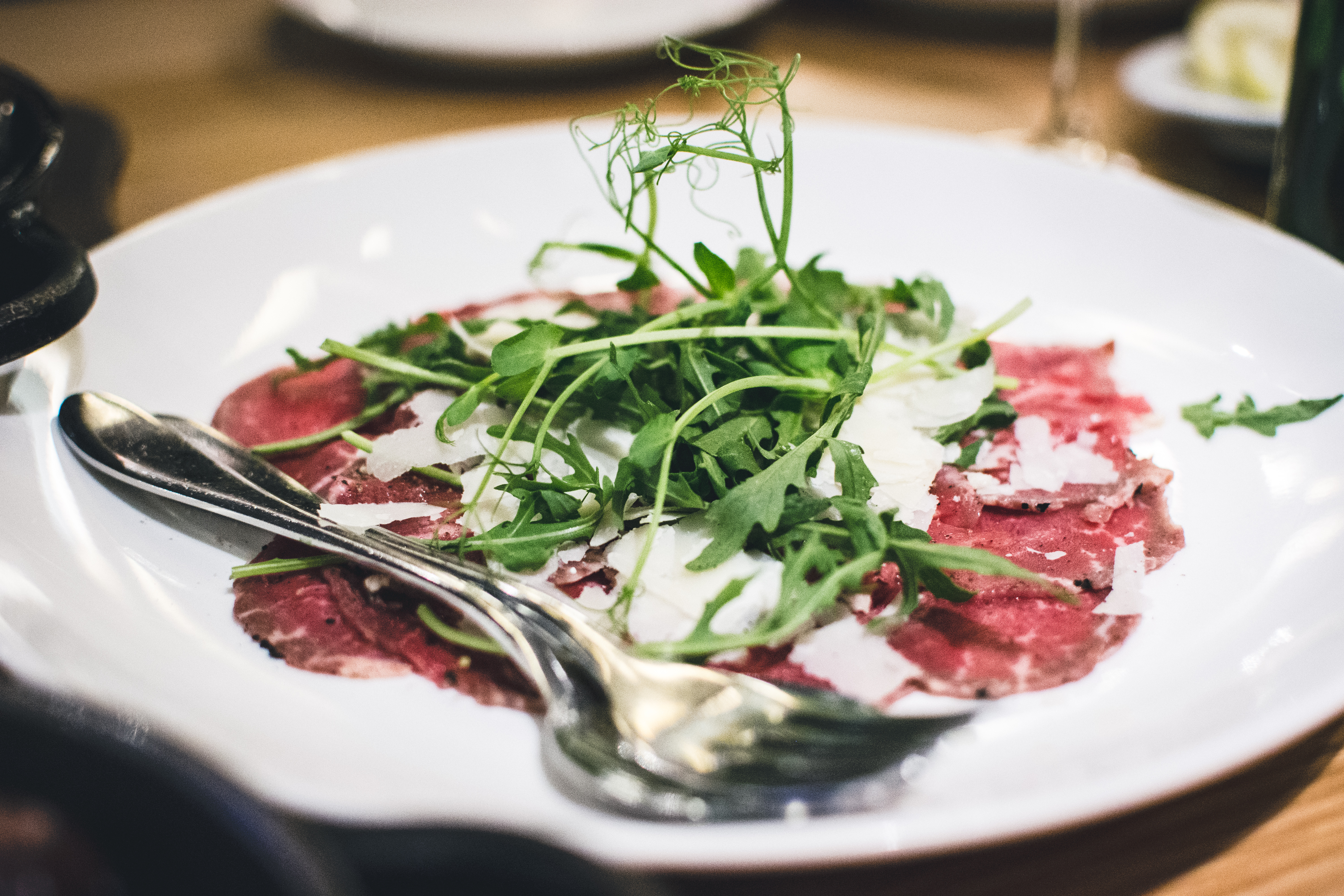 Bresaola carpaccio with rocket leaf