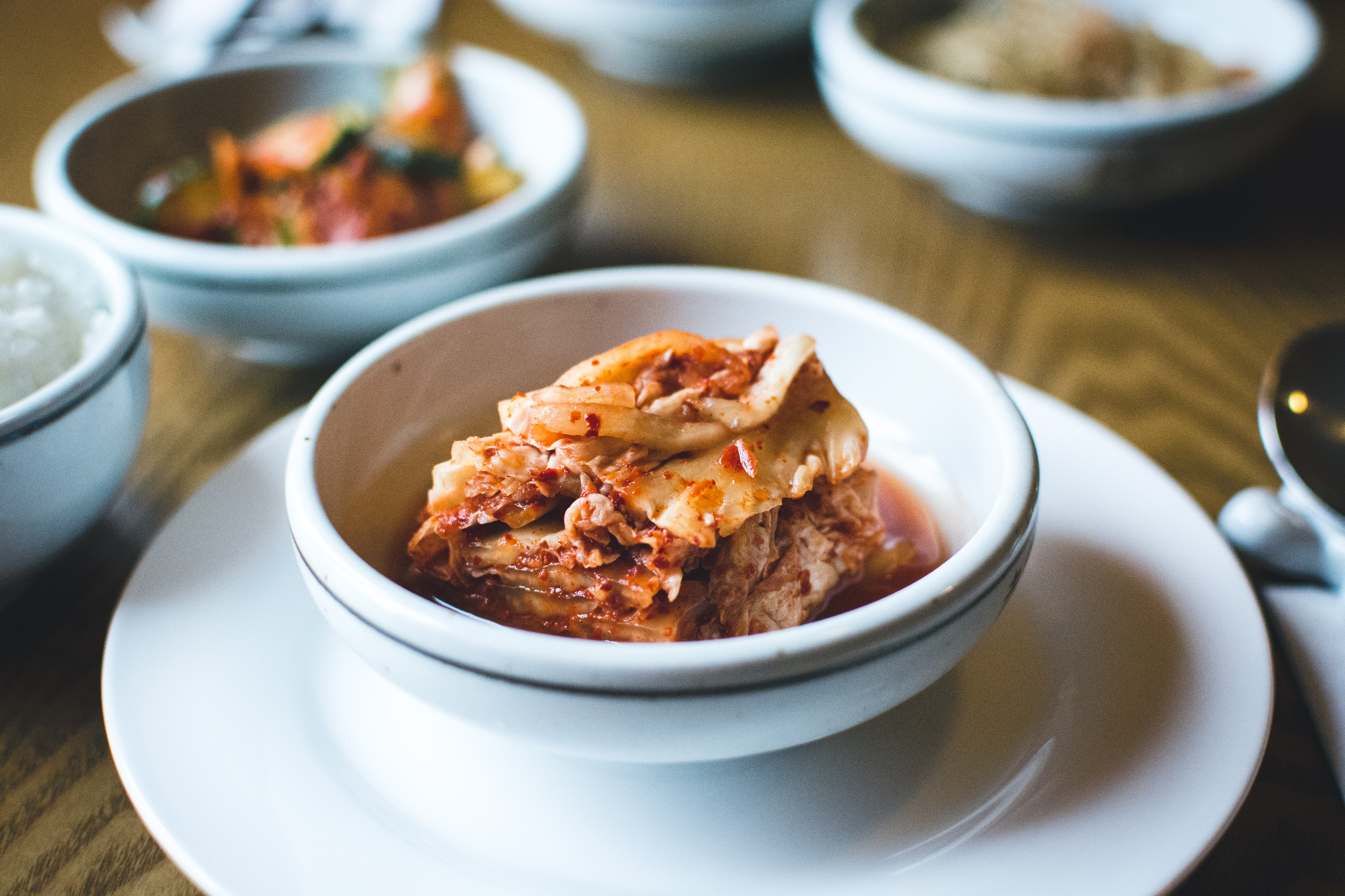 Kimchi in a white bowl close up