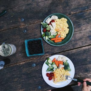 Healthy breakfast with eggs while camping