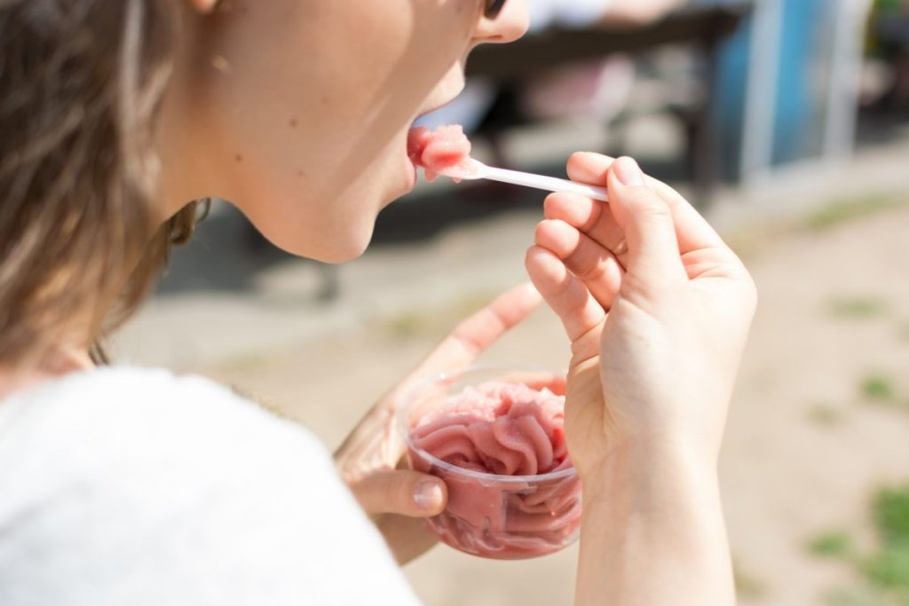 Lady eating strawberry sorbet