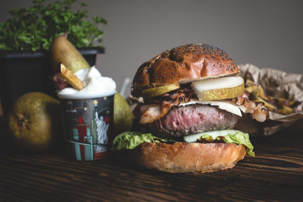 Delicious burger with pears and bacon