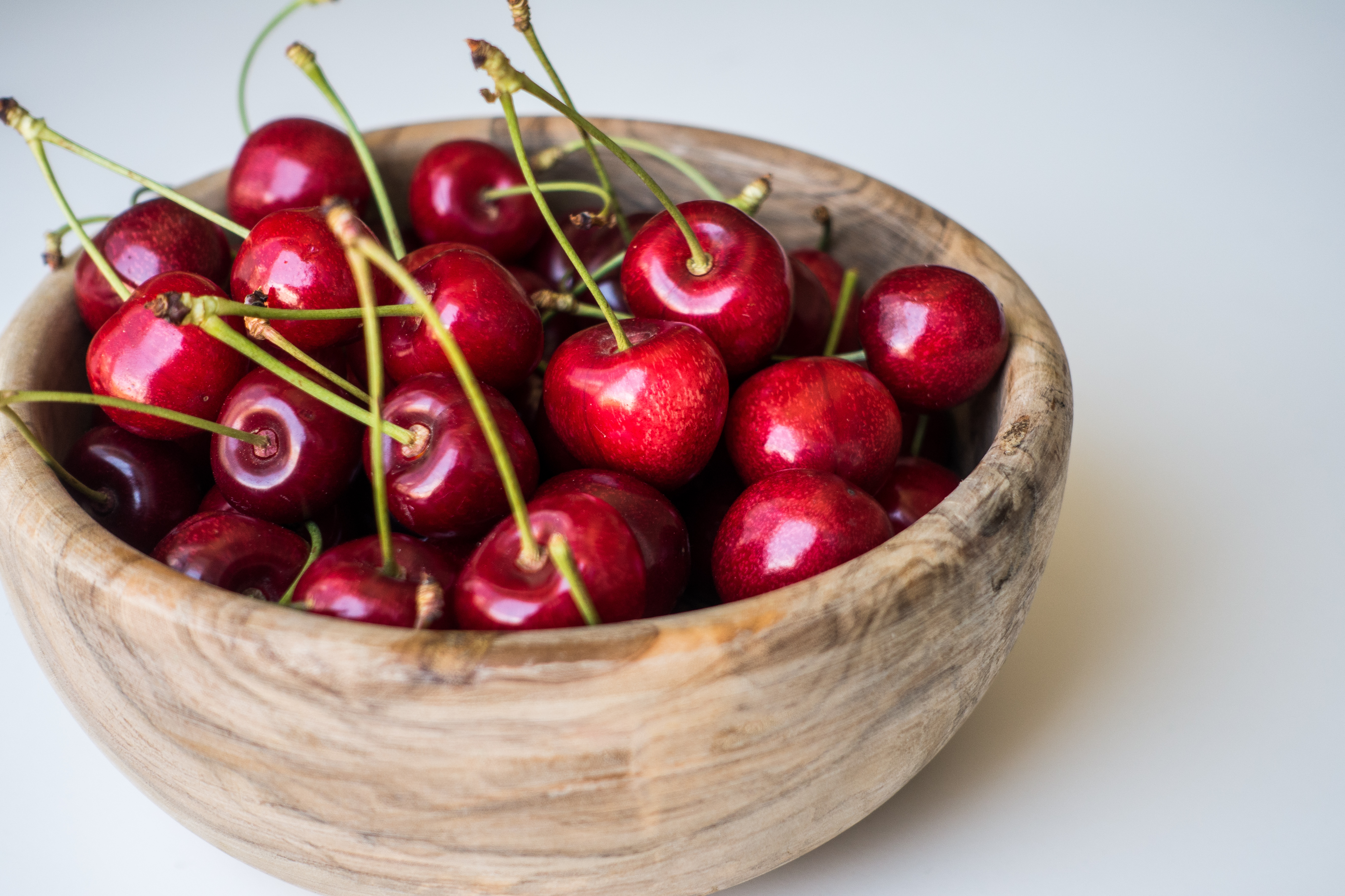 Fresh cherries in a wooden bowl
