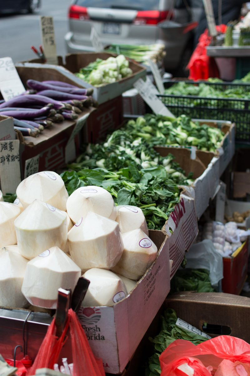 Stall with coconuts and vegetables in Chinatown NYC