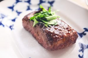 Beef steak with herb and salt close up