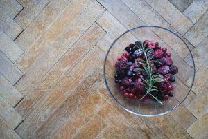 Frozen berries on a wooden floor
