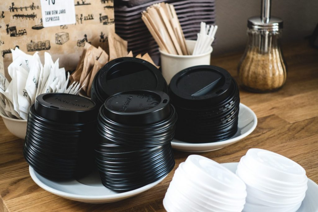 Black paper cup lids for takeaway coffee