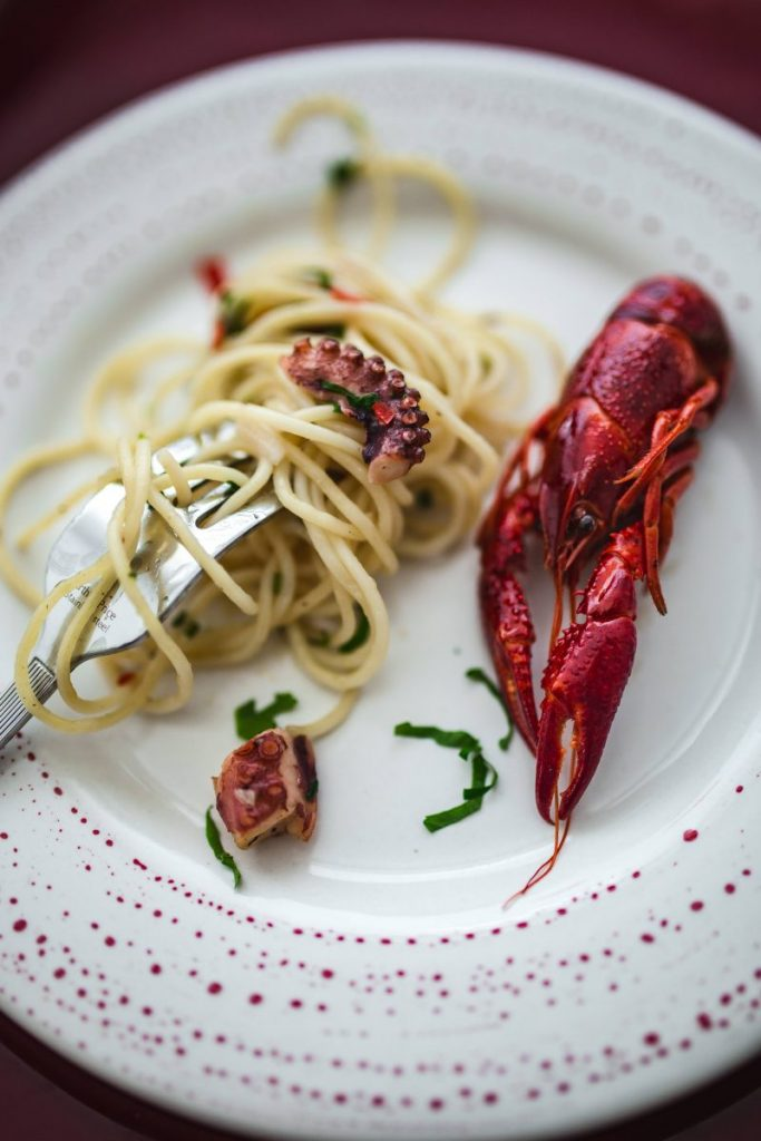 Fancy dinner with seafood pasta and crayfish