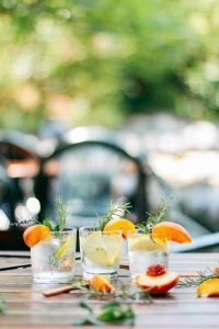 Tonic with fruits and rosemary