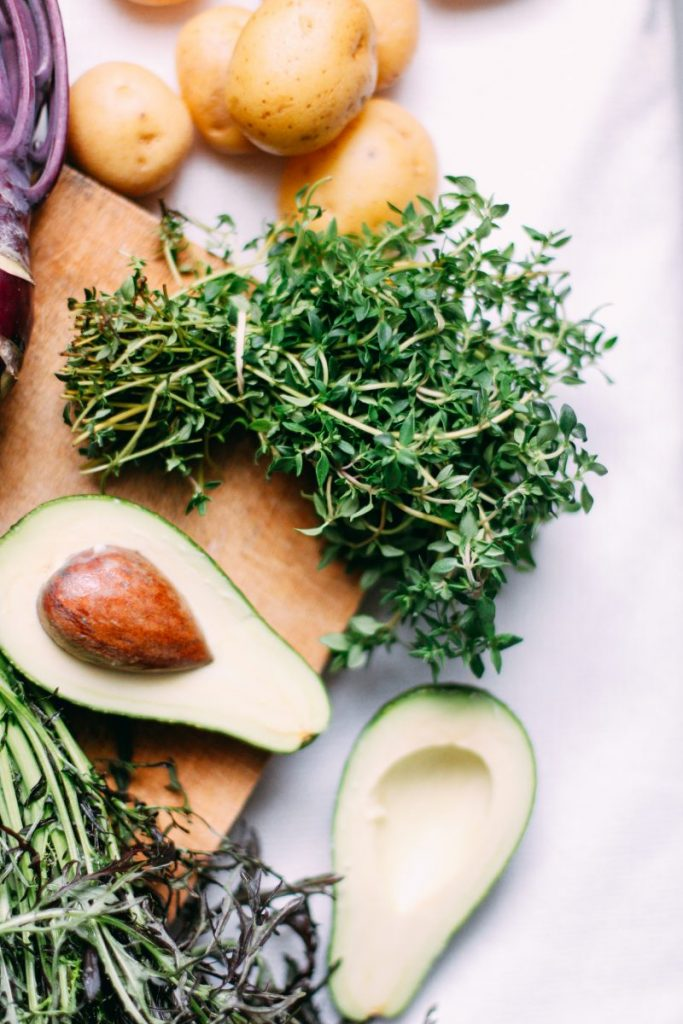 Thyme with avocado and potatoes close up