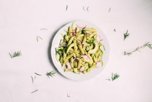 Penne with pesto, avocado and radishes