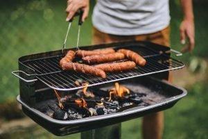 Man grilling sausages