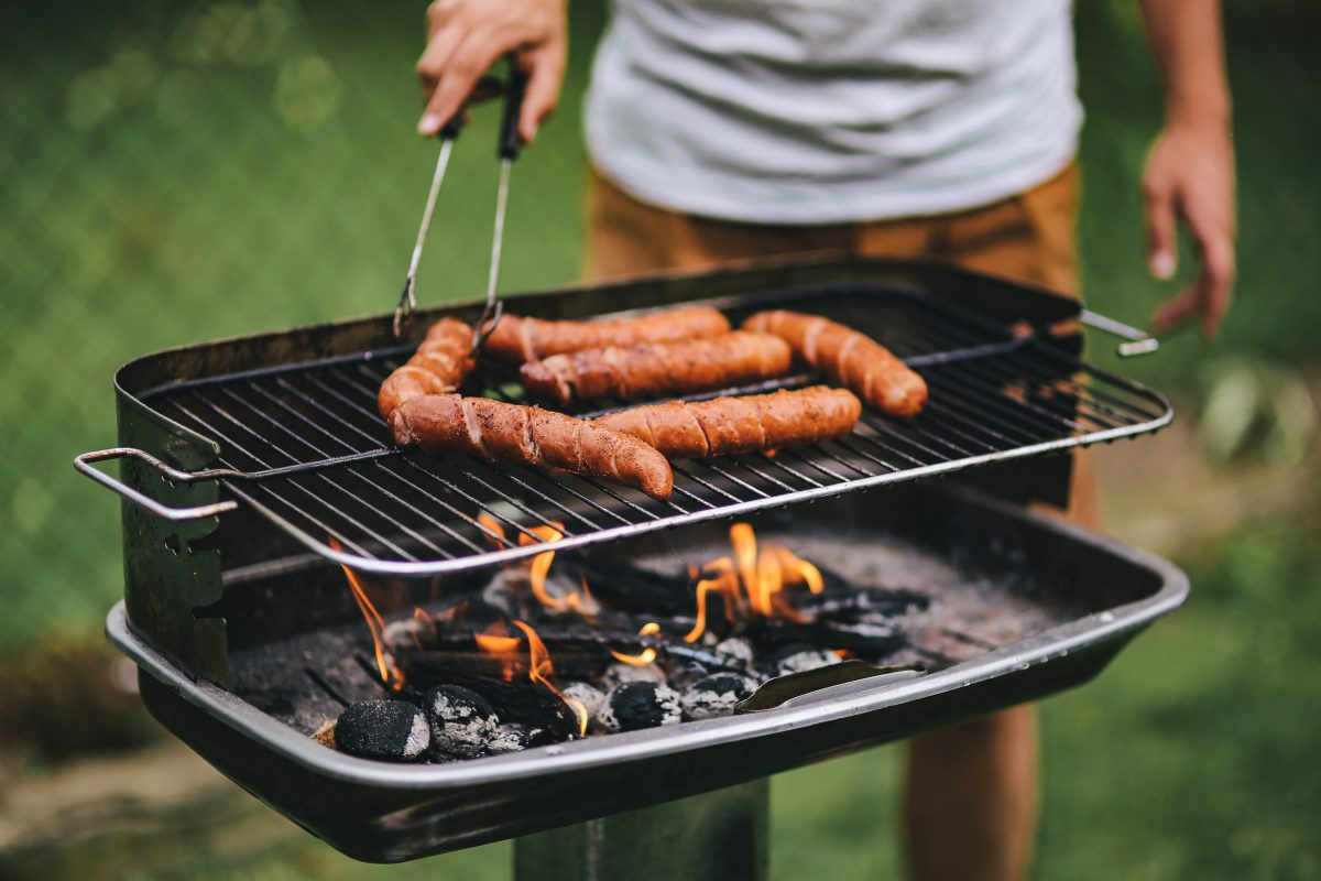 Man grilling sausages