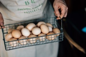 Man holding eggs