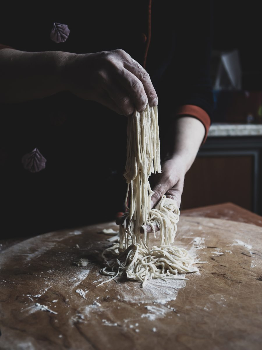 Man making homemade spaghetti