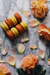 Orange and yellow macarons with flowers