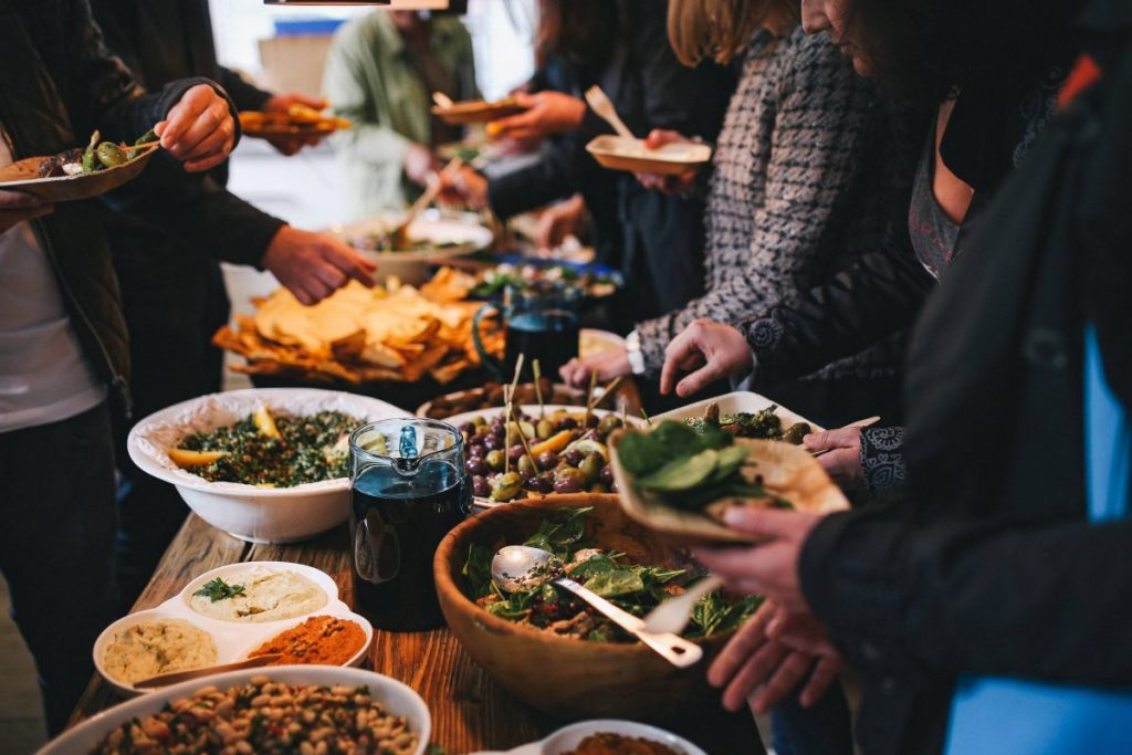 People feasting on healthy salad buffet