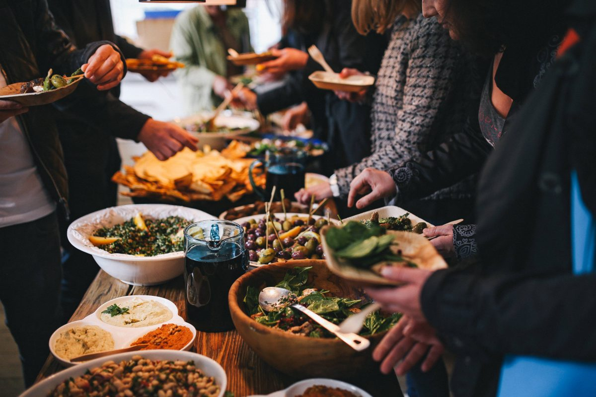 People feasting on healthy salad buffet