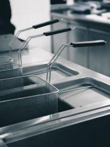 Shiny clean fryer in a restaurant kitchen