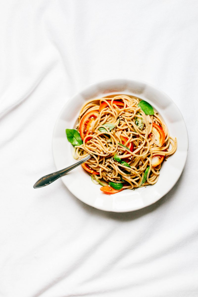 Spaghetti with fresh tomatoes and basil leafs