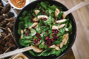 Spinach, pomegranate and chicken salad