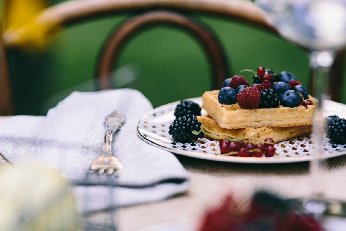 Sweet waffles with berries outside