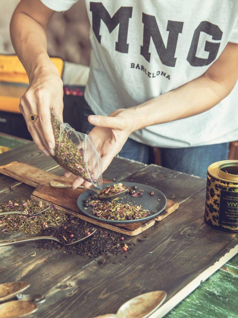 Woman dividing tea leafs