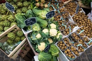 Cauliflower, potatoes and other vegetables at a market
