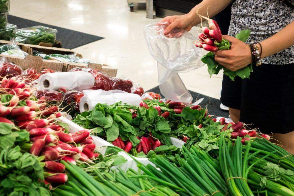 Girl buying radishes