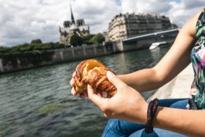 Girl snacking on croissant