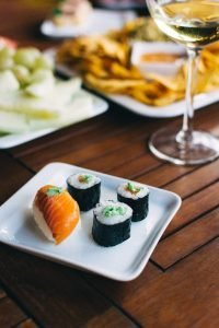 Sushi nigiri and maki with wasabi on a summer party