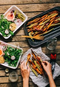 Fresh vegetables with sweet potato fries
