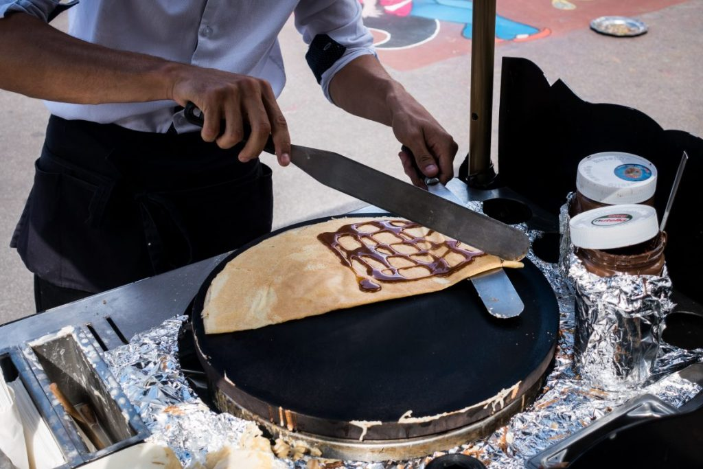 Man making pancakes on the street